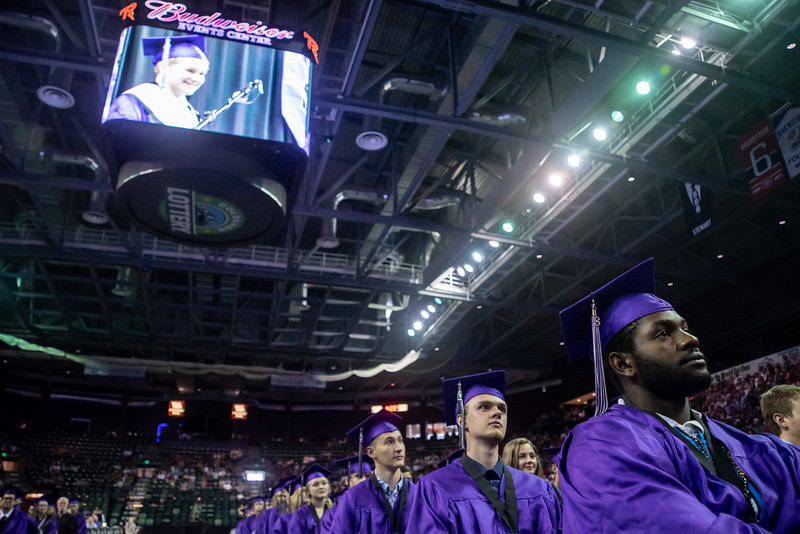 Travis Lukasiewicz, 19, watches the valedictorian, Cameron Piccone, speak during the Mountain View High School graduation on Saturday, May 26 at the Budweiser Events Center in Loveland.