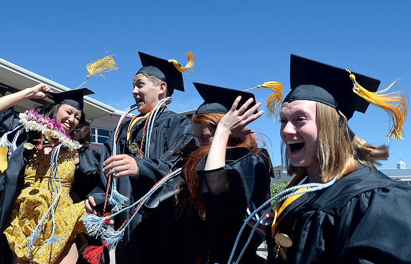 Thompson Valley High School graduates jump in the air while celebrating their graduation Saturday, May 26, 2018, moments after their commencement ceremony at the Budweiser Events Center at The Ranch in Loveland. From left are Zoe Keeler, Gavin Hanel, Isabella (Izze) Johnson, and Morgan Lessman.  (Photo by Jenny Sparks/Loveland Reporter-Herald)