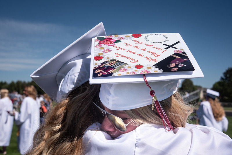 Ashlee Burdette, 18, right, hugs fellow graduate Jordan Hull, 18, after releasing butterflies to honor their friend and classmate Gabriel Archuleta who died in September. The butterfly release followed the graduation ceremony on Saturday, May 26 at Berthoud High School.