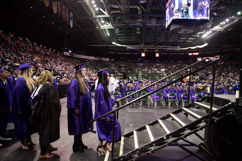 Mountain View High School graduate Taija Hollowed, 17, climbs the stairs to get her diploma during the Mountain View High School graduation on Saturday, May 26 at the Budweiser Events Center in Loveland.