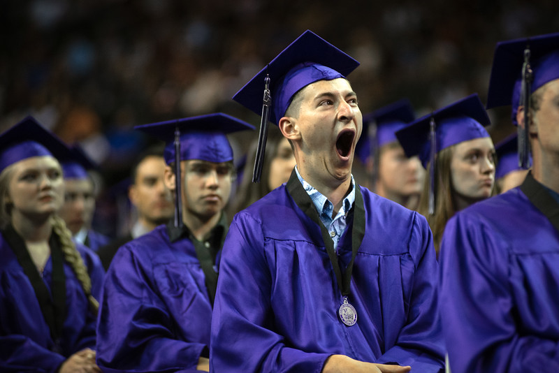 Dyson Bassett, 18, yawns during the Mountain View High School graduation on Saturday, May 26 at the Budweiser Events Center in Loveland.