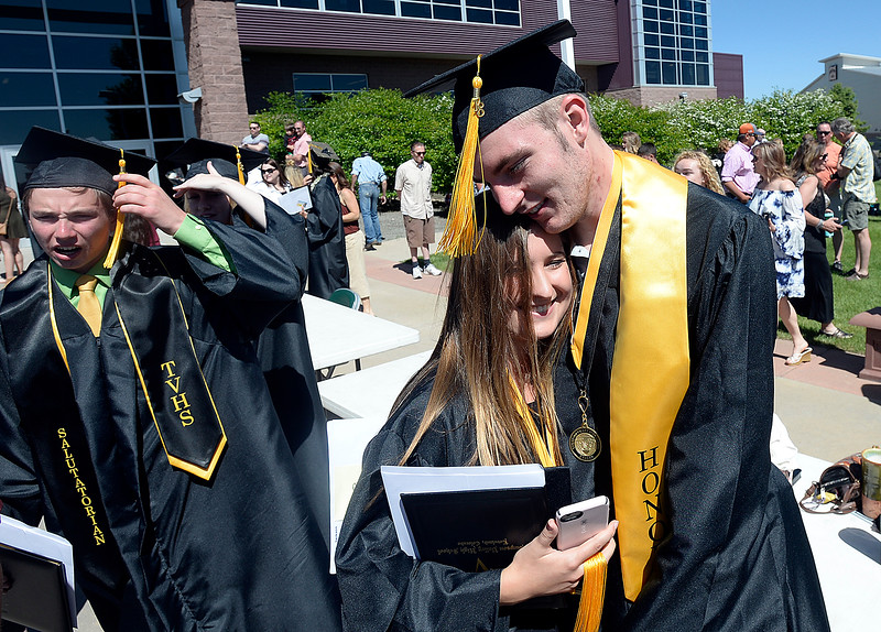 Thompson Valley High School graduates Carolyn Keating, left, and Jackson Gibbens hug after their graduation ceremony Saturday, May 26, 2018, at the Budweiser Events Center at The Ranch in Loveland.   (Photo by Jenny Sparks/Loveland Reporter-Herald)