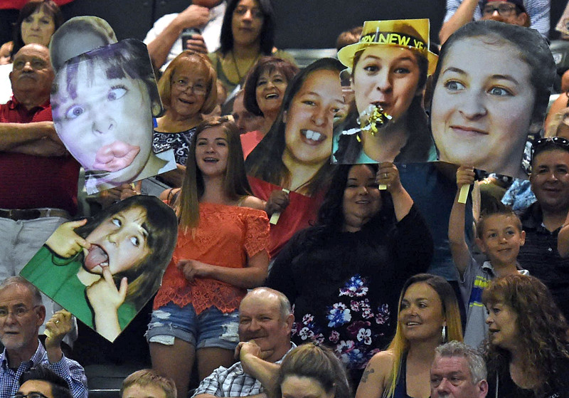 Family and friends hold photos of a Thompson Valley High School graduate during the graduation ceremony Saturday, May 26, 2018, at the Budweiser Events Center at The Ranch in Loveland.   (Photo by Jenny Sparks/Loveland Reporter-Herald)