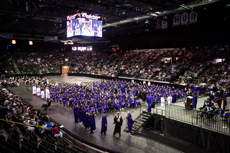 Graduates take the stage to get their diplomas during the Mountain View High School graduation on Saturday, May 26 at the Budweiser Events Center in Loveland.