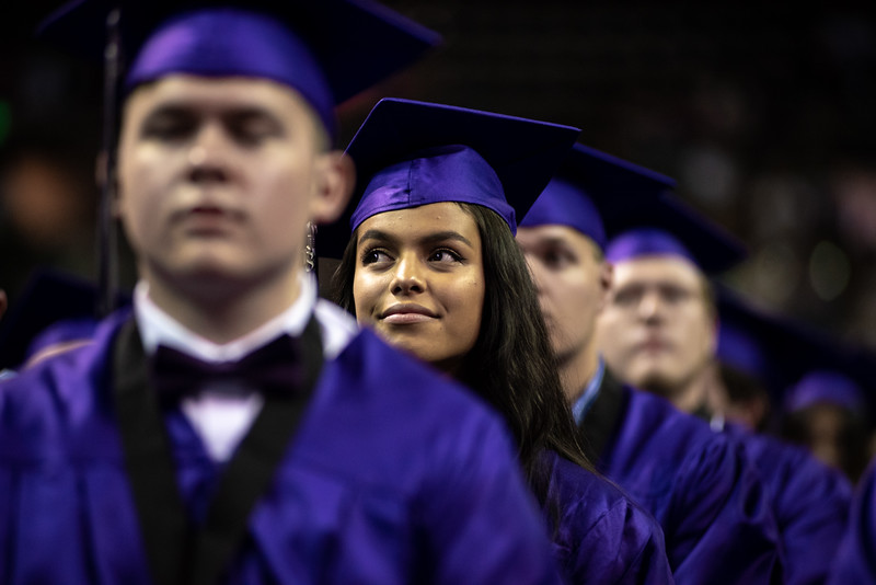 Janette Perez, 17, smiles during the Mountain View High School graduation on Saturday, May 26 at the Budweiser Events Center in Loveland.