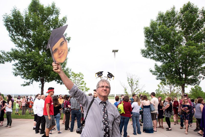 Ken Cormier of Loveland, waits for his son Joe Cormier, 18, following the Mountain View High School graduation on Saturday, May 26 at the Budweiser Events Center in Loveland.