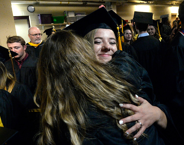 Thompson Valley High School graduates Gwen Sheldon, left, and Alayna McCrimmon hug Saturday, May 26, 2018, moments after their commencement ceremony at the Budweiser Events Center at The Ranch in Loveland.  (Photo by Jenny Sparks/Loveland Reporter-Herald)