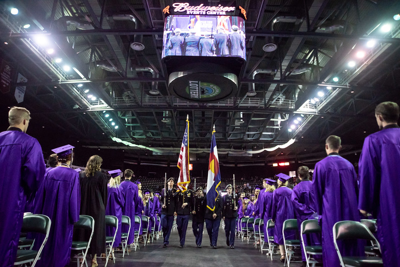Graduates stand as the colors are brought in during the Mountain View High School graduation on Saturday, May 26 at the Budweiser Events Center in Loveland.