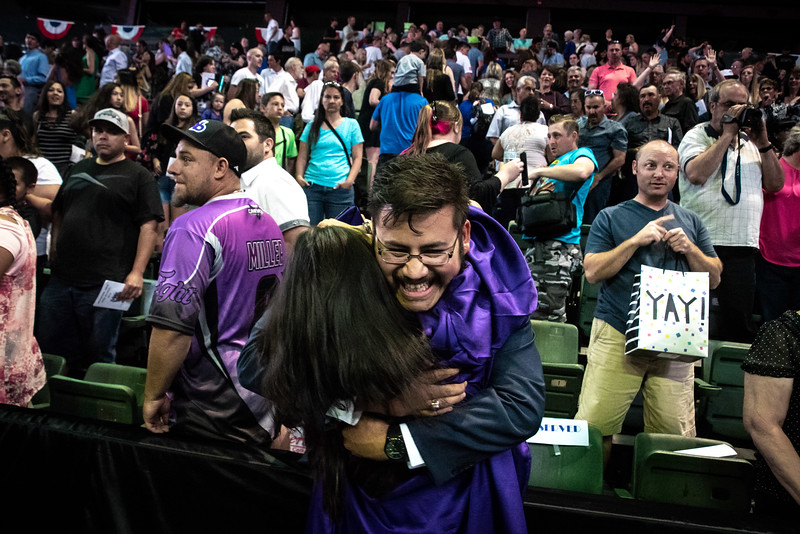 Emilio Perez hugs his sister Janette Perez, 17, following the Mountain View High School graduation on Saturday, May 26 at the Budweiser Events Center in Loveland.