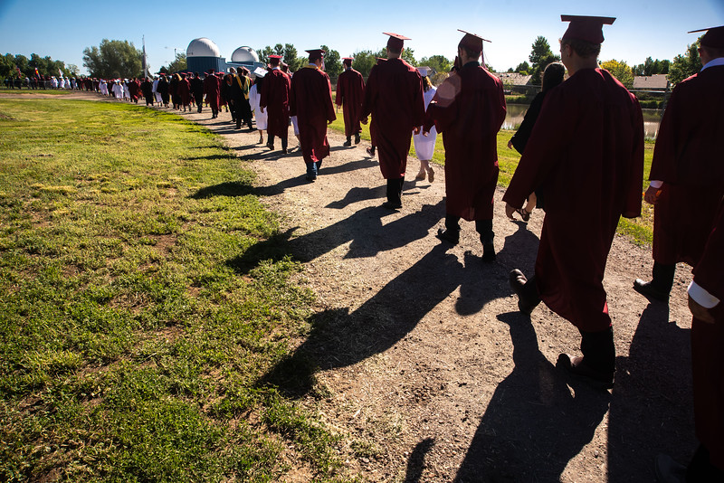 Berthoud High School graduates march onto Max Marr field for the graduation ceremony on Saturday, May 26 at Berthoud High School.