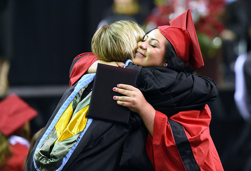 Loveland High School graduate Molly Dedam hugs counselor Cindy Case during her graduation ceremony Saturday, May 26, 2018, at the Budweiser Events Center at The Ranch in Loveland.   (Photo by Jenny Sparks/Loveland Reporter-Herald)