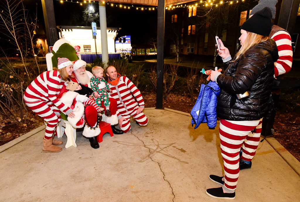 . LONGMONT, CO - NOVEMBER 23:From left: Sarah Young, Levi Grosvenor, 6 months, Santa, Cooper Grosvenor, 2 3/4 years old, and Jared Grosvenor pose as Vanessa Young and Porter Temple take photos during the tree lighting at the 6th Avenue Plaza in Longmont on Nov. 23, 2018. This year the tree lighting ceremony features LMNO Puppets, caroling, crafts, food, goodie bags and an appearance by Santa. (Photo by Matthew Jonas/Staff Photographer)