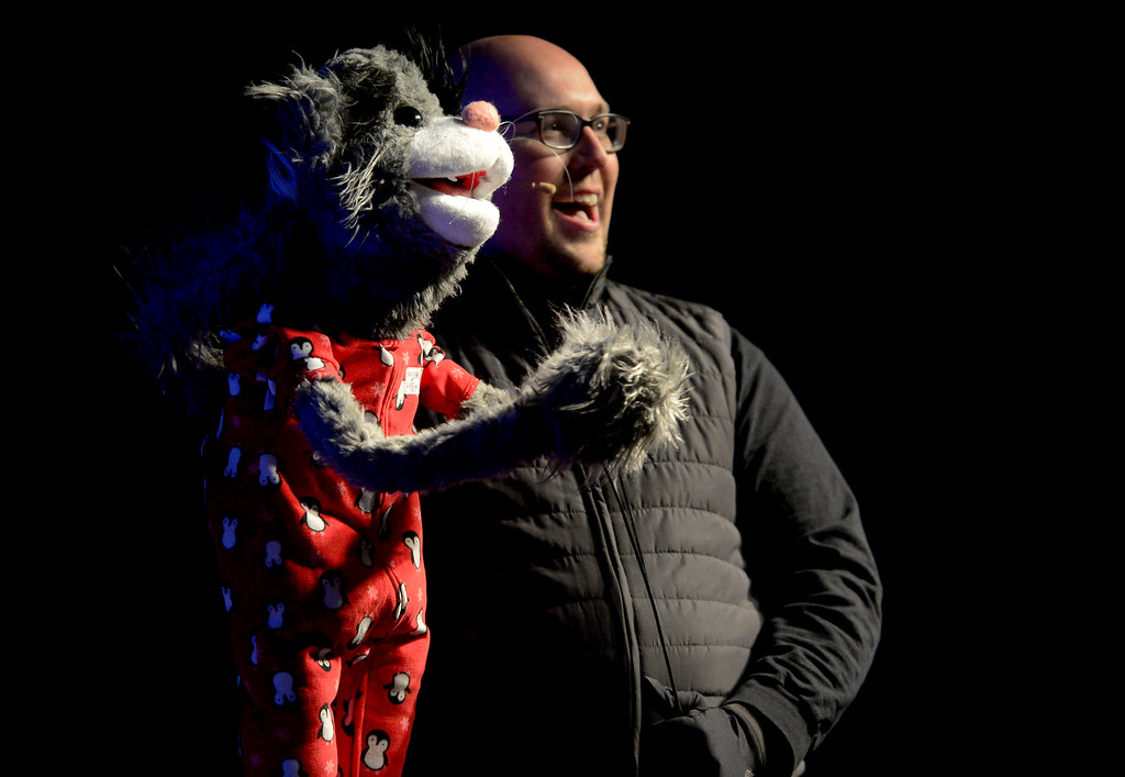 . LONGMONT, CO - NOVEMBER 23:Patrick Paws and Matt Bethune on stage during the tree lighting at the 6th Avenue Plaza in Longmont on Nov. 23, 2018. This year the tree lighting ceremony features LMNO Puppets, caroling, crafts, food, goodie bags and an appearance by Santa. (Photo by Matthew Jonas/Staff Photographer)
