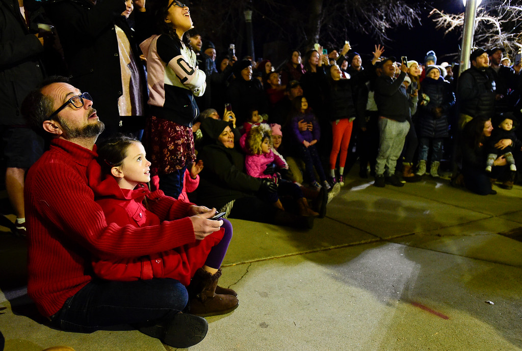 . LONGMONT, CO - NOVEMBER 23:From left: Dehru Cromer and Veda Cromer, 8, both of Longmont, watch as the tree is lighted at the 6th Avenue Plaza in Longmont on Nov. 23, 2018. This year the tree lighting ceremony features LMNO Puppets, caroling, crafts, food, goodie bags and an appearance by Santa. (Photo by Matthew Jonas/Staff Photographer)