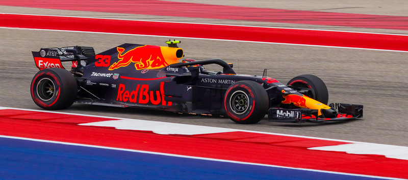 Max Verstappen, with undercarriage skid plate bottoming out and sparking.
