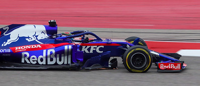 Pierre Gasly, close up side view of car's front section. Note front tire is compressing under the forces of the turn. A set of tires cost about $6,000.00 U.S. dollars and last 25 to 45 laps, not enough to finish one race..
