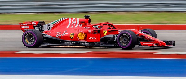 "Sparks fly under Sebastian Vettel's Ferrari as he whips through the wicked ""S"" turns of the Circuit of the Americas in Austin."