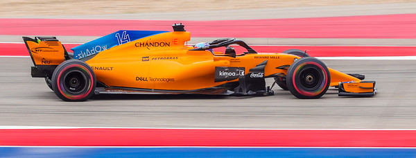 Shutter speed of 1/320 of a second is fast, but not fast enough to stop the wheels on Fernando Alonso's  Formula One car.