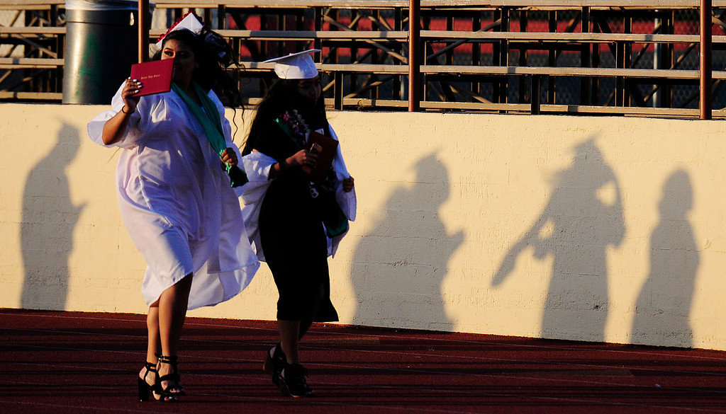 . VALLEJO, CA - JUNE 7, Graduates cast shadows as they leave the Vallejo High School graduation on Thursday. (CHRIS RILEY/TIMES-HERALD)