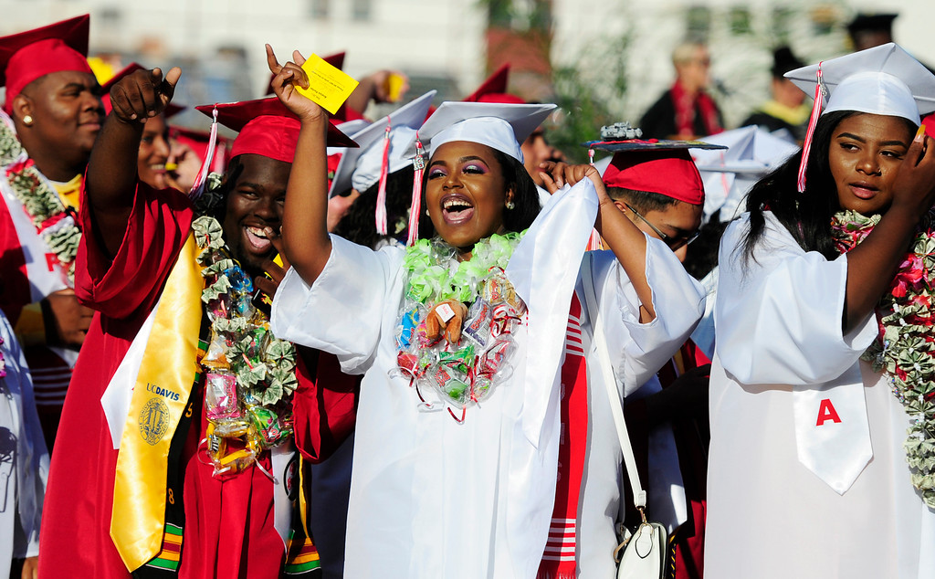 . VALLEJO, CA - JUNE 7, Anaiya Porter waves to her family during the Vallejo High School graduation on Thursday. (CHRIS RILEY/TIMES-HERALD)