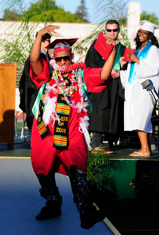 . VALLEJO, CA - JUNE 7, Soundaita Brown dances down the ramp after getting his diploma during the Vallejo High School graduation on Thursday. (CHRIS RILEY/TIMES-HERALD)