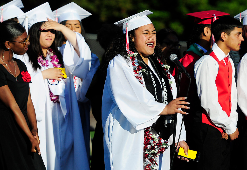. VALLEJO, CA - JUNE 7, LaRae Uiagalelei sings a solo as the choir sings \'Rise Up\' during the Vallejo High School graduation on Thursday. This was the first time in 20 years that Vallejo High has had a choir for the entire year. (CHRIS RILEY/TIMES-HERALD)