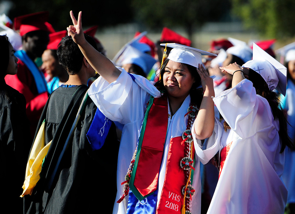 . VALLEJO, CA - JUNE 7, Valedictorian, Theresa Altares, signals to her family during the Vallejo High School graduation on Thursday. (CHRIS RILEY/TIMES-HERALD)