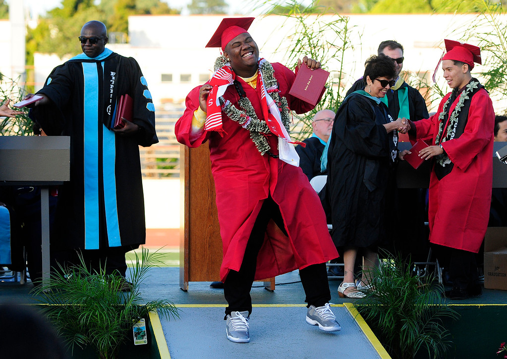 . VALLEJO, CA - JUNE 7, Cameron Appling dances after getting his diploma during the Vallejo High School graduation on Thursday. (CHRIS RILEY/TIMES-HERALD)