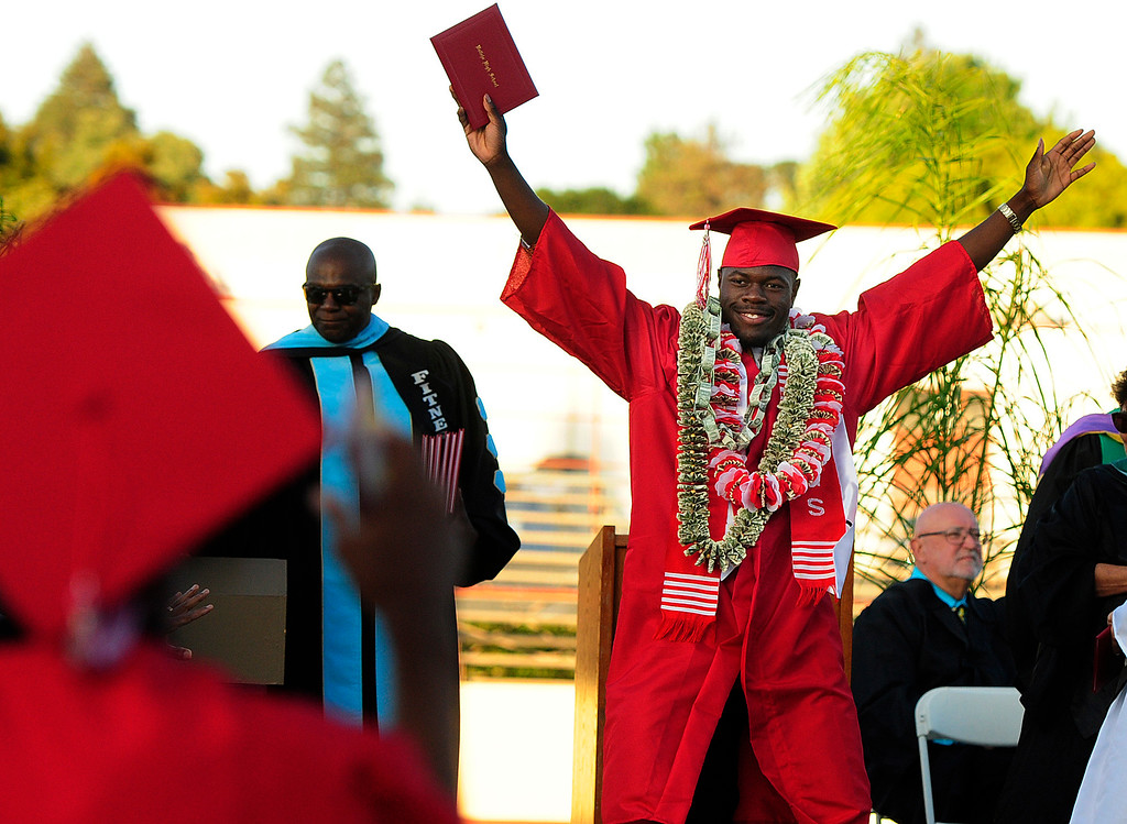 . VALLEJO, CA - JUNE 7, George Bind celebrates after walking the stage during the Vallejo High School graduation on Thursday. (CHRIS RILEY/TIMES-HERALD)