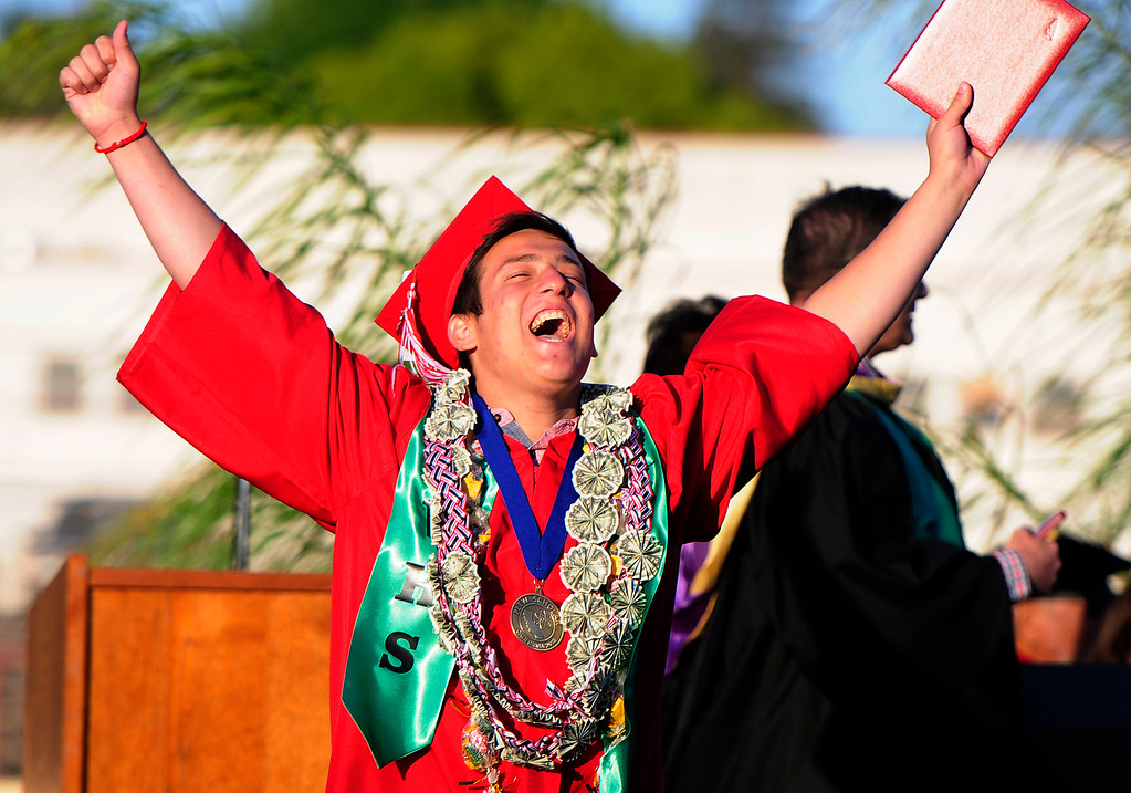 . VALLEJO, CA - JUNE 7, Luis Cutolo celebrates after receiving his diploma during the Vallejo High School graduation on Thursday. (CHRIS RILEY/TIMES-HERALD)