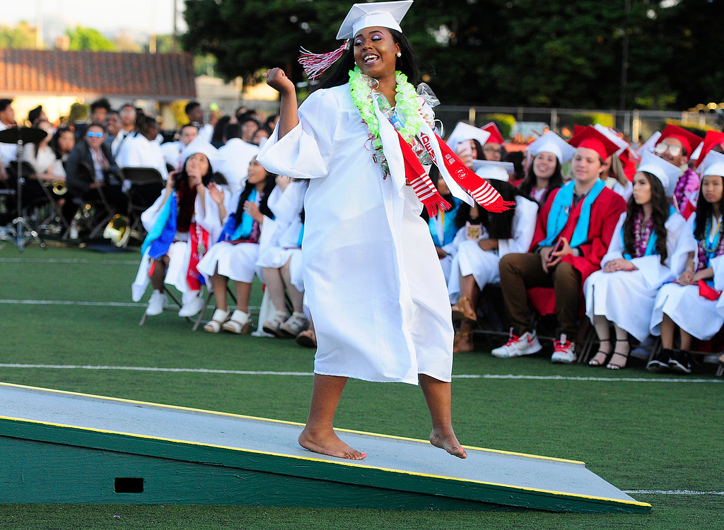 . VALLEJO, CA - JUNE 7, Anaiya Porter walks down the ramp barefoot afer getting her diploma during the Vallejo High School graduation on Thursday. (CHRIS RILEY/TIMES-HERALD)
