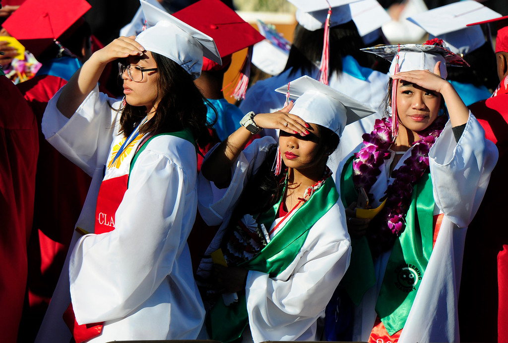 . VALLEJO, CA - JUNE 7, Graduates look into the sun to find their family during the Vallejo High School graduation on Thursday. (CHRIS RILEY/TIMES-HERALD)