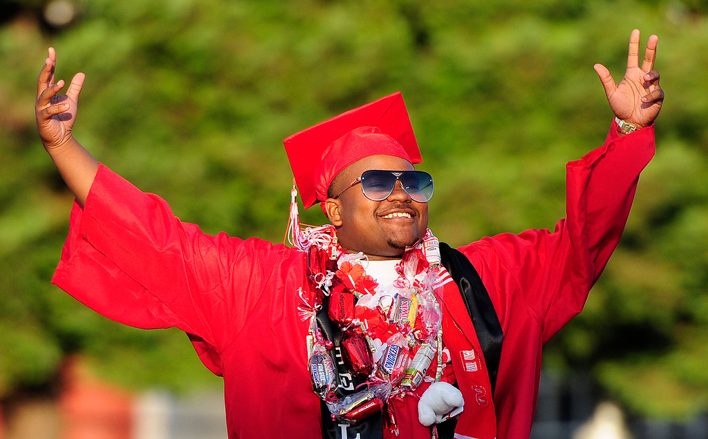 . VALLEJO, CA - JUNE 7, Desmond Keil celebrates as he walks across the stage during the Vallejo High School graduation on Thursday. (CHRIS RILEY/TIMES-HERALD)