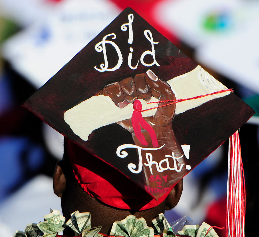 . VALLEJO, CA - JUNE 7, A graduate makes a statement with his cap during the Vallejo High School graduation on Thursday. (CHRIS RILEY/TIMES-HERALD)