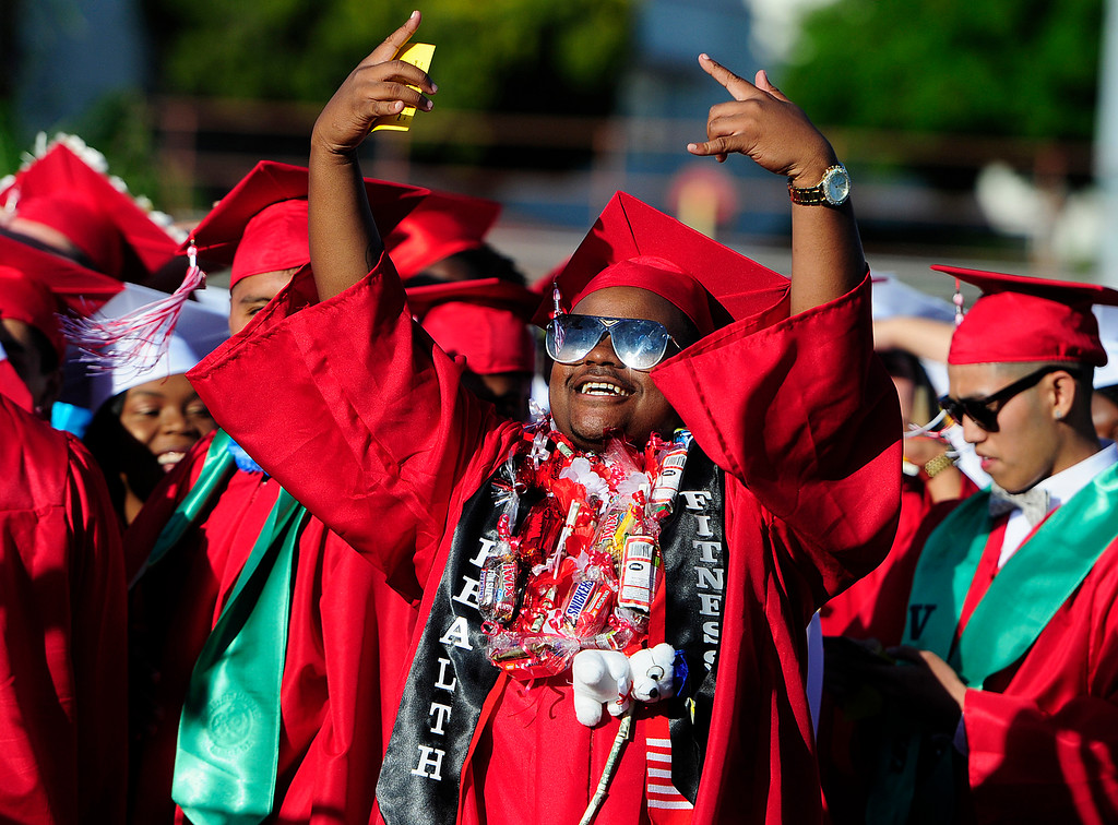 . VALLEJO, CA - JUNE 7, Desmond Kiel waves to his family during the Vallejo High School graduation on Thursday. (CHRIS RILEY/TIMES-HERALD)