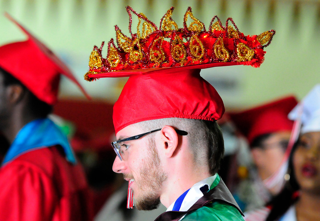. VALLEJO, CA - JUNE 7, Salutatorian Samuel Moser, who usually sports a mohawk, decorated his cap with fire to symbolize his hairstyle for the Vallejo High School graduation on Thursday. (CHRIS RILEY/TIMES-HERALD)