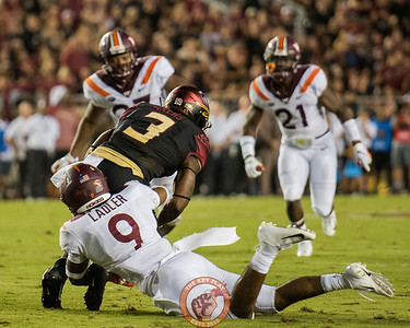 Khalil Ladler (9) tackles FSU's Cam Akers (3) during the matchup between Virginia Tech and Florida State at Doak Campbell Stadium, Monday, Sept. 3, 2018. (Photo by Cory Hancock)