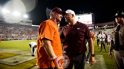 Bud Foster and Justin Fuente celebrate after the 24-3 win over the Seminoles, Monday, Sept. 3, 2018. (Photo by Cory Hancock)