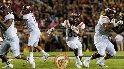 Deshawn McClease (33) runs up the middle in the matchup between Virginia Tech and Florida State at Doak Campbell Stadium, Monday, Sept. 3, 2018. (Photo by Cory Hancock)