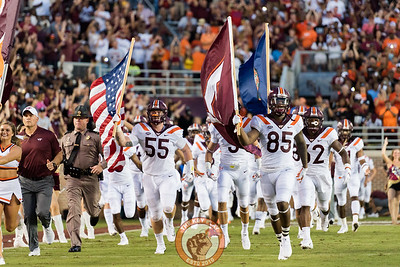 The Hokies take the field before the matchup between Virginia Tech and Florida State at Doak Campbell Stadium, Monday, Sept. 3, 2018. (Photo by Cory Hancock)