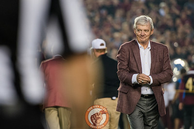 Frank Beamer walks off the field after participating in the coin toss as an honorary captain before the matchup between Virginia Tech and Florida State at Doak Campbell Stadium, Monday, Sept. 3, 2018. (Photo by Cory Hancock)