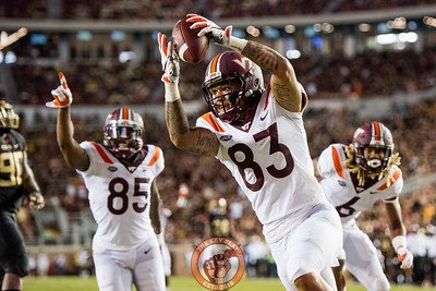 Eric Kumah (83) celebrates a blocked punt returned for a touchdown in the matchup between Virginia Tech and Florida State at Doak Campbell Stadium, Monday, Sept. 3, 2018. (Photo by Cory Hancock)