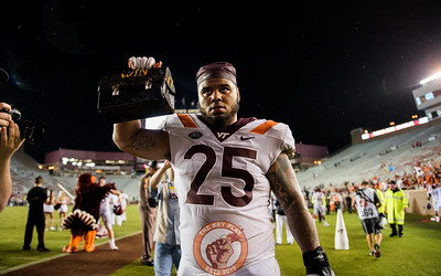 Ricky Walker holds up the Lunch Pail after the matchup between Virginia Tech and Florida State at Doak Campbell Stadium, Monday, Sept. 3, 2018. (Photo by Cory Hancock)