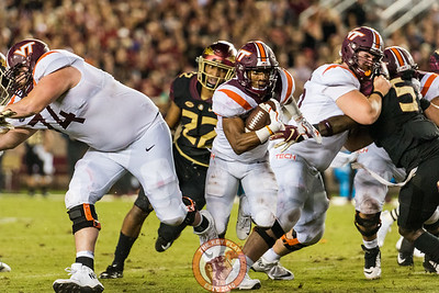 Deshawn McClease runs through a narrow hole in the matchup between Virginia Tech and Florida State at Doak Campbell Stadium, Monday, Sept. 3, 2018. (Photo by Cory Hancock)
