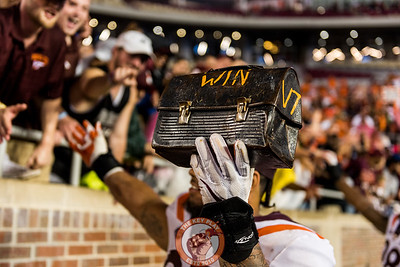 Ricky Walker holds up the Lunch Pail as he celebrates with fans after the matchup between Virginia Tech and Florida State at Doak Campbell Stadium, Monday, Sept. 3, 2018. (Photo by Cory Hancock)
