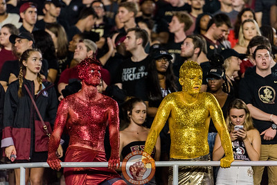 FSU fans painted in garnet and gold glitter look on as the Seminoles fall to the Hokies 24-3 in the matchup between Virginia Tech and Florida State at Doak Campbell Stadium, Monday, Sept. 3, 2018. (Photo by Cory Hancock)