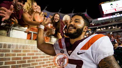 Josh Jackson celebrates the Hokies' 24-3 victory over the Seminoles with fans after the matchup between Virginia Tech and Florida State at Doak Campbell Stadium, Monday, Sept. 3, 2018. (Photo by Cory Hancock)