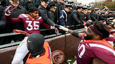 Zion Debose (35) hops up onto the railing with the Corps of Cadets as the team walks by to high five fans after the game. The Hokies earned their 26th consecutive bowl bid with a 41-20 win over Marshall. (Mark Umansky/TheKeyPlay.com
