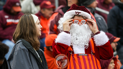 A Hokie-colored Santa Claus adjusts his sunglasses in the stands. (Mark Umansky/TheKeyPlay.com)