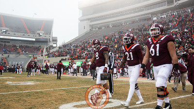 The Virginia Tech captains walk to midfield for the pregame coin toss. (Mark Umansky/TheKeyPlay.com)